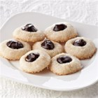 Shortbread Thumbprints with Bittersweet Ganache - Tender, buttery little shortbread thumbprint cookies have a sweet filling of smooth dark chocolate in this pretty addition to your holiday table.