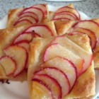 Apple Tartlets - Fresh red apples are thinly sliced and arranged on puff pastry creating a delightful dessert perfect for the fall.
