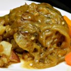 Chef John's Smothered Pork Chops  - Poultry seasoning is the special secret spice that gives a flavor twist to comforting home-style pork chops simmered in rich onion gravy.