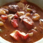 Big Charlie's Gumbo - A roux cooked to a deep reddish-brown is what gives gumbo it 's distinctive flavor.  This gumbo incorporates andouille sausage, cubes of beef, crab and shrimp in a highly seasoned stew with okra.
