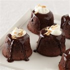 Individual Chocolate-Amaretto Lava Cakes - Served individually with a dollop of whipped cream on top, these little chocolate cakes with a liquid chocolate-amaretto center make impressive gourmet desserts.