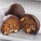 Peanut Butter-Pretzel Bonbons - Sweet and savory, these bon bons with peanut butter and crushed pretzels make the perfect little treat.