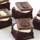 Red Velvet Squares - Rich, dark chocolate brownie squares are topped with cream cheese frosting and Ghirardelli® Holiday Impressions.