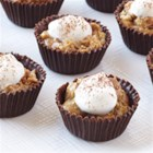 Tiramisu Cups - These mini tiramisu cups are filled with a creamy blend of espresso-flavored pudding, a dollop of whipped cream, and a dusting of cocoa powder.