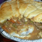 Wyoming Stew - Wonderful stew recipe with crescent rolls laid on top in a pie formation. I used this recipe when I used to work up in Cody, Wyoming.  If you do not own a cast-iron skillet, use a 9-inch casserole dish instead, and cook the filling in a saucepan.  Makes a lovely presentation.