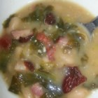 Dad's Escarole and Bean Soup - Tomatoes and cannellini beans simmer with escarole in this Italian-inspired soup.
