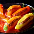 Bob's Stuffed Banana Peppers - This is an awesome recipe for banana peppers stuffed with an Italian sausage mixture and baked in a delicious tomato sauce. We get requests to make them for the guys my husband works with all the time.