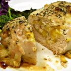 Apple and Cheddar Stuffed Chicken - Chicken breasts are stuffed with apples and white Cheddar cheese and then baked until tender and juicy in this comfort food recipe.