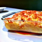 Parmesan-Crusted Au Gratin Potatoes and Onion - This recipe for potatoes and onions mixed with a creamy cheese sauce and baked with a crispy cheese topping is a terrific side dish.