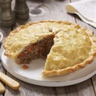 "French Canadian Pork Pie ""Tourtière"" - Grace your holiday table with the traditional savoury pie from Quebec. This one is served with a spicy apple raisin chutney."