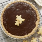 Gingerbread Pie - This custard pie has the warm, spicy flavour of gingerbread, rich with molasses, and is decorated with piecrust gingerbread men.