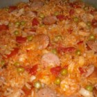 One Dish Jambalaya - Chicken, Italian sausage and shrimp simmered with rice, peas, garlic and picante sauce for that jambalaya bite.
