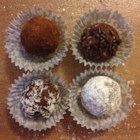 Cocoa Rum Balls - This delicious smooth confection is an impressive dessert for the holidays. These are wonderful for parties, and perfect for holiday gifts to your loved ones. A half cup of orange juice plus one teaspoon of freshly grated orange peel can be substituted for the rum in this recipe.