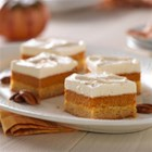 Maple-Pumpkin Pie Bars - Pumpkin bars with a hint of maple flavor have cake on the bottom, a creamy middle layer, and a layer of fluffy whipped topping to finish. Sprinkle with cinnamon and toasted pecans for the perfect touch.