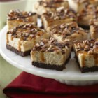 Turtle Cheesecake from Karo(R) - Creamy, caramel cheesecake is drizzled with chocolate and caramel and sprinkled with chopped pecans.