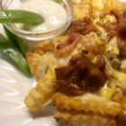 Yummy Cheese Fries - Easy and fast, these Cheddar cheese fries are served with bacon and dipped in ranch dressing.
