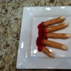Bloody Fingers - Pretzel rods are coated in a peanut butter mixture, garnished with an almond for a 'finger nail', and dipped in plum jam for 'blood' creating creepy bloody fingers for Halloween.