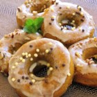 Maple Pumpkin Doughnuts - Baked maple pumpkin doughnuts are dipped in a maple glaze and finished with chopped pumpkin seeds for a tasty treat in the fall.