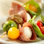 Italian Salami Appetizer Kebabs - Fresh basil leaves curled around cherry tomatoes, savory meatballs and Margherita(R) Hard Salami-wrapped mozzarella balls, all skewered one-by-one to make one beautiful appetizer.