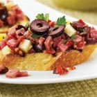 Margherita(R) Sun-Dried Tomato and Salami Bruschetta - Diced Margherita(R) Genoa salami, smoked Gouda cheese, chopped calamata olives and zesty seasoning make for a light yet satisfying appetizer.