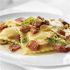 Pumpkin Ravioli with Crispy Margherita(R) Prosciutto - Savory Margherita(R) Prosciutto, sautéed garlic, mushrooms and pine nuts over sweet pumpkin ravioli in a rich buttery Amaretto sauce.