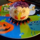 Monster Ball - Halloween partygoers will get a treat from this truly delicious cheese ball with a spooky look.