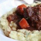 Beef and Guinness(R) Stew - Beer, beef, and bacon add deep, complex flavors to this Irish-inspired stew that's at its best when served with mashed potatoes.