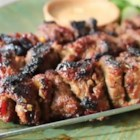 How to Make Beef Satay - Strips of top sirloin are marinated in a zesty Thai-inspired mixture and grilled on skewers for meat that's tasty and tender.