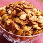 Baked Pumpkin Seeds - Baked pumpkin seeds coated in ranch dressing mix are a tasty treat during the Halloween season.