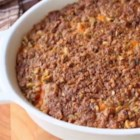 Chef John's Sweet Potato Casserole  - Sweet potato casserole flavored with maple syrup has a crunchy topping of pistachios and brown sugar for a side dish that's perfect for holiday meals.