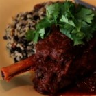 Lamb Shank Vindaloo - Lamb shanks are slow cooked with garam masala, ginger, paprika, cayenne, onions, and garlic for a tasty variation of a classic Indian vindaloo.