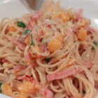 Ham and Butternut Squash Spaghetti - Smoked ham, butternut squash, and mascarpone cheese combine to create a decadent yet light sauce in this delicious spaghetti dish.