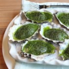 Chef John's Oysters Rockefeller - Oysters on the half shell are topped with a butter and herb puree and baked, creating one of America's iconic dishes served at Antoine's in New Orleans.