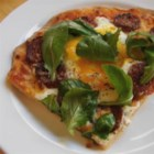 Chef John's Sausage and Egg Pizza - A pizza of cheese and sausage gets the delicious addition of lightly baked eggs for a treat that may change the way you eat eggs and pizza forever.