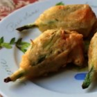 Fried Stuffed Squash Blossoms  - Delicate squash blossoms are filled with savory goat cheese, dipped in a light batter, and fried to a crisp golden brown for a unique appetizer or side dish.