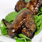 Halloween Black Bat Wings - Bat wings are actually chicken wings dressed in a tasty sauce made black with food coloring for a fun Halloween appetizer.