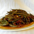 Slow-Cooked Green Beans - It's nice to cook fresh green beans to a buttery, tender texture over several hours with bacon, garlic, and onion for a different take on the often-chewy green bean. This recipe makes plenty of delicious juice that's just right for dipping corn bread.