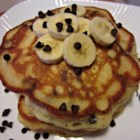 Banana Chocolate Chip Pancakes - Bananas and chocolate chips are folded into traditional pancake batter creating a sweet treat for weekend breakfast.