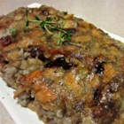 "Vegetarian Stuffing - I take this to our family gathering for the holidays. Everyone likes it - the ""meat eaters"" don't miss the giblets. You can make it vegan by deleting the mushroom soup and increasing the broth, also use no/low fat soup if you like. Multi-grain, nut and sourdough breads all work great.  Originally submitted to ThanksgivingRecipe.com.  Pecans can be substituted for walnuts."