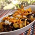 Bethany's Frito(R) Pie - Corn chips, chili, Cheddar cheese, and onion are all you need to make this hearty, budget-friendly casserole.