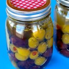 Marinated Olives - Already-pungent olives--Kalamata and Manzanilla--get punched up with additional herbs and spices; two days in the refrigerator brings out the most flavor.