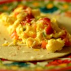 Tex-Mex Migas - Sprinkle crushed tortilla chips over spicy eggs and wrap in a tortilla with Cheddar cheese for a Tex-Mex breakfast favorite from central Texas.