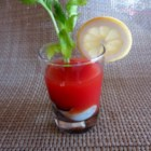 Oyster Shooters - Raw oysters in tomato juice and vodka, garnished with lemon.