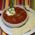 Cuddle Up Chili - Cuddle up with a warm bowl of spicy chili filled to the brim with beans, ground beef, and tomatoes on those cold weekend evenings.