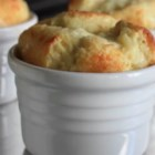 Apple and Cheddar Cheese Souffles - A puffy sweet-and-savory souffle combines sharp Cheddar cheese with sweet, caramelized apples for an easy treat they'll think you slaved over.
