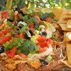 Jen's Nine Layer Dip - Scoop up this Mexican-inspired 9-layer salad with tortilla chips. It's hearty enough for a light meal, and makes a great bring-along dish for a grill party.