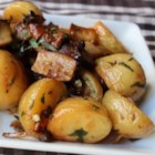 Roasted Wild Mushrooms and Potatoes - Roasted small potatoes and wild mushrooms are seasoned with fresh tarragon and garlic and drizzled with sherry vinegar for a warm salad or side dish perfect for fall.
