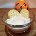 Crabby Horseradish Dip - Quick, easy, warm, creamy and ADDICTIVE!!! This very simple crabmeat dip will put a smile on the face of even your crabbiest guests! Serve with your favorite crackers and pretzels.