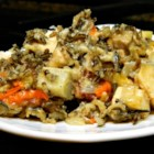 The Best Artichoke Chicken Buffet - Wild rice and chicken pieces mixed with a plethora of vegetables, sherry and cream and baked into a delectable 'buffet'!