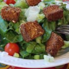 Jenny's Seasoned Croutons - Baked multigrain bread cubes are coated in butter and Cajun seasoning creating crunchy and flavorful croutons perfect for any salad.
